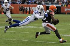 Indianapolis Colts free safety Darius Butler (20) tackles Cleveland Browns wide receiver Andrew Hawkins (16) during the fourth quarter at FirstEnergy Stadium. Mandatory Credit: Ken Blaze-USA TODAY Sports