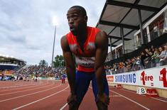 Tyson Gay of the U.S. reacts after winning in the 100m event of the Lausanne Diamond League meeting in Lausanne, July 4, 2013.               REUTERS/Denis Balibouse