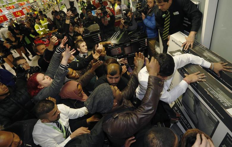 Shoppers compete to purchase retail items on ''Black Friday'' at an Asda superstore in Wembley, north London November 28, 2014. REUTERS/Luke MacGregor
