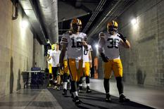 Dec 21, 2014; Tampa, FL, USA; Green Bay Packers quarterback Aaron Rodgers (12) walks to the field before  the Green Bay Packers beat the Tampa Bay Buccaneers 20-3 at Raymond James Stadium. Mandatory Credit: David Manning-USA TODAY Sports