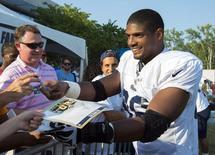 Jul 29, 2014; St. Louis, MO, USA; St. Louis Rams defensive lineman Michael Sam (96) signs autographs after practice at Rams Park. Scott Rovak-USA TODAY Sports