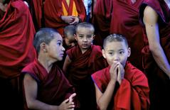 Young Buddhist monks leave an examination hall after attending their final examinations inside the Kagyu Nalanda Institute in the Dickey Larsoe settlement, a Tibetan settlement, in Bylakuppe, southwest of Bengaluru, previously known as Bangalore, December 4, 2014. REUTERS/Abhishek N. Chinnappa