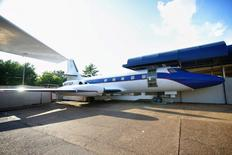 """""""Hound Dog II"""", a Lockheed Jetstar owned by entertainer Elvis Presley, is displayed at Graceland in Memphis, Tennessee, in this undated publicity photo released to Reuters January 2, 2015. Elvis Presley's pair of personal jets, one complete with gilded wash basin and plush sleeping quarters, will go under the hammer in a sealed-bid auction for a piece of mile-high rock and roll memorabilia, Julien's Auctions said on Friday. REUTERS/Julien's Auctions/Handout via Reuters"""