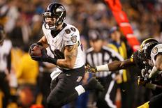 Jan 3, 2015; Pittsburgh, PA, USA; Baltimore Ravens tight end Crockett Gillmore (80) scores a touchdown against the Pittsburgh Steelers in the second half during the 2014 AFC Wild Card playoff football game at Heinz Field. Charles LeClaire-USA TODAY Sports