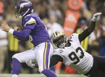 New Orleans Saints outside linebacker Junior Galette (93) reaches for Minnesota Vikings quarterback Matt Cassel in the first quarter at Mercedes-Benz Superdome in New Orleans, in this file photo taken September 21, 2014.   REUTERS/Crystal LoGiudice-USA TODAY Sports/Files
