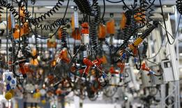 Various tools are seen hanging from the ceiling at the engine manufacturing unit for the new Mercedes AMG GT super sports cars during a factory tour for journalists at the Mercedes AMG headquarters in Affalterbach near Stuttgart, September 9, 2014. REUTERS/Kai Pfaffenbach