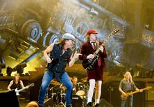Rock band AC/DC lead guitarist Angus Young (R) and vocalist Brian Johnson perform during a concert at the Telenor Arena in Fornebu, near Oslo February 18, 2009. REUTERS/Sara Johannessen/Scanpix Norway