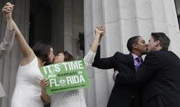 From right to left; Jeff Delmay, Todd Delmay, Karla Arguello and Catherina Pareto kiss after the same-sex couples were married in Miami, Florida, January 5, 2015. REUTERS/Javier Galeano