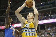 Nov 29, 2013; Denver, CO, USA; Denver Nuggets center Timofey Mozgov (25) shoots the ball against New York Knicks guard Tim Hardaway Jr. (5) during the second half at Pepsi Center. The Nuggets won 97-95.  Mandatory Credit: Chris Humphreys-USA TODAY Sports