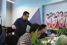 Ma Baoli, founder of Blue City,  parent company of Chinese gay dating app Blued, supervises his staff at the company's office in Beijing,  January 7, 2015. REUTERS/Guo Yeqi