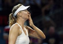 Maria Sharapova of Russia blows a kiss to fans after defeating Elina Svitolina of Ukraine in their women's singles semi final match at the Brisbane International tennis tournament in Brisbane, January 9, 2015.    REUTERS/Jason Reed