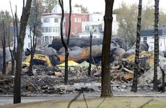 An emergency worker stands on the site of the train wreck in Lac Megantic, July 16, 2013. REUTERS/Ryan Remiorz/Pool