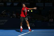 Roger Federer of Switzerland plays a forehand return during his men's singles semi final win over Grigor Dimitrov of Bulgaria at the Brisbane International tennis tournament in Brisbane January 10, 2015.    REUTERS/Jason Reed