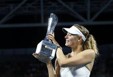 Maria Sharapova of Russia holds the Brisbane International tennis tournament women's singles trophy after defeating Ana Ivanovic of Serbia in Brisbane, January 10, 2015.    REUTERS/Jason Reed