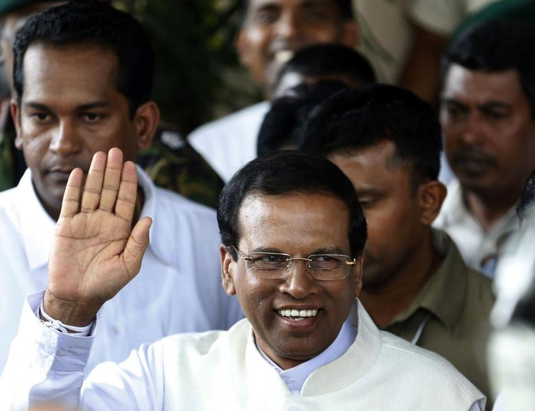 Sri Lanka's newly elected president Mithripala Sirisena waves at media as he leaves the election commission in Colombo January 9, 2015. REUTERS/Dinuka Liyanawatte