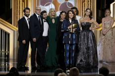 "Producer and writer Jill Soloway (4th R) accepts the Golden Globe Award for Best TV Series, Comedy or Musical for ""Transparent"" at the 72nd Golden Globe Awards.  REUTERS/Paul Drinkwater/NBC"