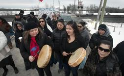 First Nation's bands form a blockade at the main VIA rail line between Toronto and Ottawa near Marysville, Ontario March 19, 2014. REUTERS/Fred Thornhill