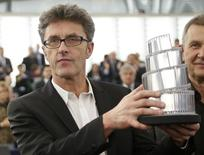 "Poland's director Pawel Pawlikowski poses with his trophy after he was awarded with the Lux cinema prize of the European Parliament for his film ""Ida' during a ceremony at the European Parliament in Strasbourg December 17, 2014.   REUTERS/Vincent Kessler"