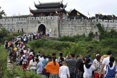 Tourists visit the Qingyan Ancient Town on the third day of the seven-day national day holiday, in Guiyang, Guizhou province October 3, 2014. REUTERS/Stringer