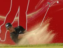Martin Kaymer of Germany hits the ball out of the bunker at 18th green during the Abu Dhabi Golf championship January 17, 2015. REUTERS/Ahmed Jadallah