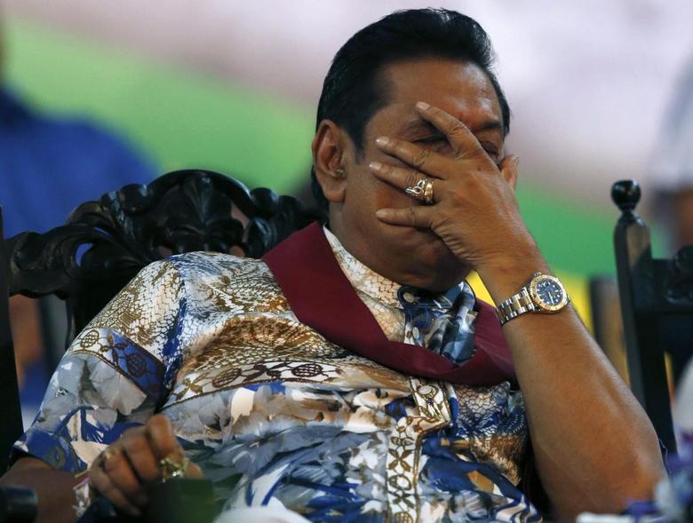 Sri Lanka's President Mahinda Rajapaksa reacts during his final rally ahead of presidential election in Piliyandala January 5, 2015. REUTERS/Dinuka Liyanawatte