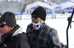 U.S. golfer Tiger Woods sits on a snow bike during the women's World Cup Super-G skiing race in Cortina D'Ampezzo January 19, 2015. REUTERS/Stringer