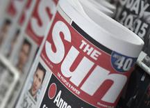 Copies of The Sun newspaper are seen on a newsstand outside a shop in central London January 20, 2015.  REUTERS/Toby Melville