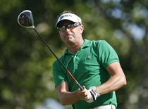 Robert Allenby of Australia follows his drive off the 18th tee during the first round of the Sony Open golf tournament in Honolulu, Hawaii in this file photo taken January 10, 2013.  REUTERS/Hugh Gentry/Files