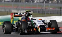 Force India Formula One driver Sergio Perez of Mexico drives during the qualifying session of the U.S. Grand Prix at the Circuit of The Americas in Austin, Texas, November 1, 2014.  REUTERS/Mike Stone
