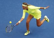 Victoria Azarenka of Belarus hits a return against Caroline Wozniacki of Denmark during their women's singles second round match at the Australian Open 2015 tennis tournament in Melbourne January 22, 2015. REUTERS/Carlos Barria