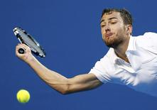 Jerzy Janowicz of Poland hits a return against Gael Monfils of France during their men's singles second round match at the Australian Open 2015 tennis tournament in Melbourne January 22, 2015. REUTERS/Thomas Peter