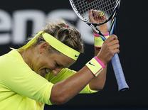 Victoria Azarenka of Belarus celebrates after defeating Caroline Wozniacki of Denmark in their women's singles second round match at the Australian Open 2015 tennis tournament in Melbourne January 22, 2015. REUTERS/Athit Perawongmetha