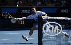 Stan Wawrinka of Switzerland reaches to hit a return to Guillermo Garcia-Lopez of Spain during their men's singles fourth round match at the Australian Open 2015 tennis tournament in Melbourne January 26, 2015. REUTERS/Thomas Peter