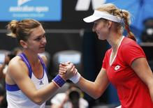 Ekaterina Makarova (R) of Russia shakes hands with Simona Halep of Romania after winning their women's singles quarter-final match at the Australian Open 2015 tennis tournament in Melbourne January 27, 2015. REUTERS/Athit Perawongmetha