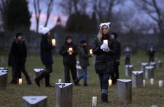 Children place candles during a commemoration ceremony for the 70th anniversary of the liberation of Auschwitz death camp, at the Jewish Cemetery in former Nazi concentration camp Terezin in Terezin January 27, 2015.   REUTERS/David W Cerny