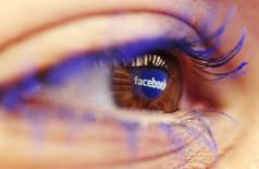 A Facebook logo reflected in the eye of a woman is seen in this picture illustration taken in Skopje November 6, 2014. Picture take November6.  REUTERS/Ognen Teofilovski