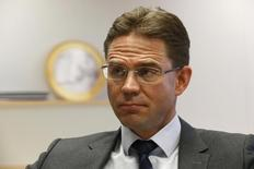 Jyrki Katainen reacts during a Reuters interview in Brussels December 18, 2014. REUTERS/Pascal Rossignol