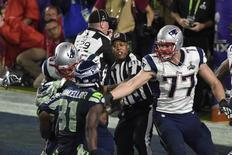 Feb 1, 2015; Glendale, AZ, USA; New England Patriots tight end Rob Gronkowski (87) and Seattle Seahawks defensive end Michael Bennett (72) scuffle near the end of the game as back judge Terrence Miles (111) tries to intervene in Super Bowl XLIX at University of Phoenix Stadium. Mandatory Credit: Kirby Lee-USA TODAY Sports
