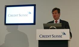 CEO Brady Dougan of Swiss bank Credit Suisse addresses a news conference to present the bank's half-year results in Zurich July 22, 2014. REUTERS/Arnd Wiegmann