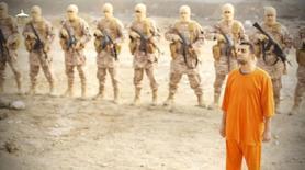 """Кадр из видеозаписи казни иорданского летчика Муаза Юсефа аль-Касасба. 3 февраля 2015 года. Иордания в среду казнила двух иракских джихадистов, включая женщину, в ответ на опубликованное """"Исламским государством"""" видео сожжения живьём, в железной клетке, иорданского военного пилота. REUTERS/Social media via Reuters TV"""