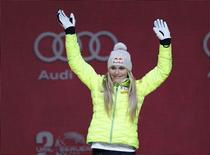 Lindsey Vonn of the United States waves to the crowd during the medals ceremony for the women's Super G in the FIS alpine skiing world championships at Championships Plaza, Vail, CO, USA Feb 3, 2015;  Mandatory Credit: Jeff Swinger-USA TODAY Sports
