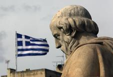 A Greek flag flutters above the statue of Greek philosopher Plato outside the Athens Academy, February 2, 2015 REUTERS/Yannis Behrakis