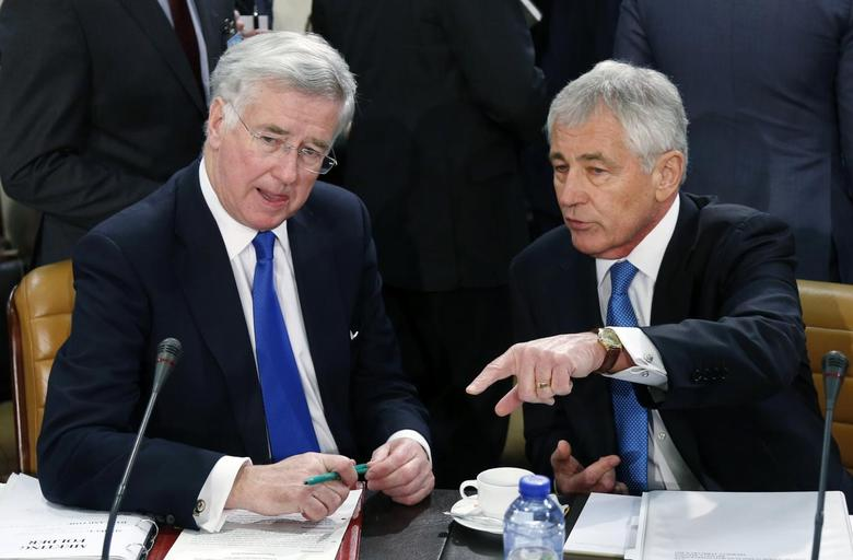 Britain's Defence Secretary Michael Fallon listens to U.S. Secretary of Defense Chuck Hagel (R) during a NATO defence ministers meeting at the Alliance headquarters in Brussels February 5, 2015. REUTERS/Francois Lenoir