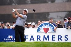 Feb 5, 2015; La Jolla, CA, USA; Phil Mickelson tees off on the 14th during the first round of the Farmers Insurance Open golf tournament at Torrey Pines Municipal Golf Course - South Course. Mandatory Credit: Jake Roth-USA TODAY Sports