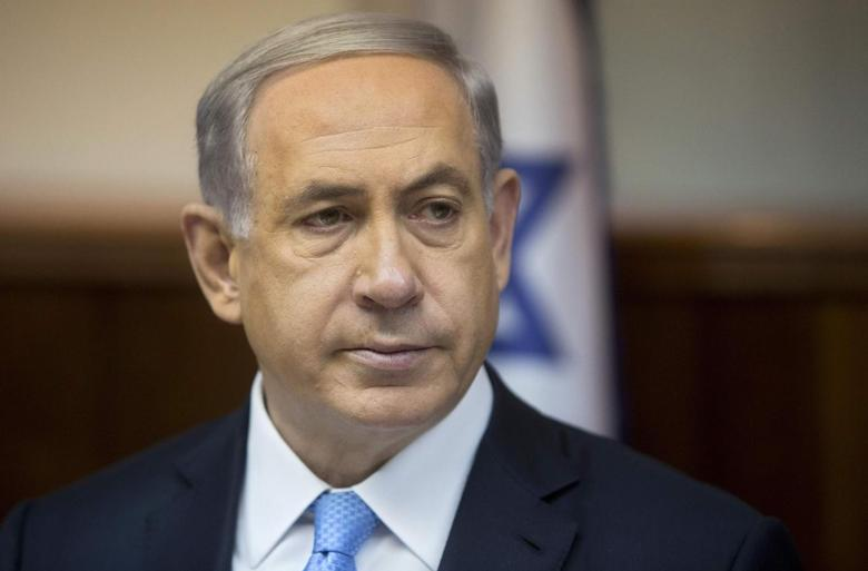 Israeli's Prime Minister Benjamin Netanyahu attends the weekly cabinet meeting in his office in Jerusalem February 8, 2015. REUTERS/Sebastian Scheiner/Pool