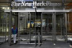 A woman exits the New York Times Building in New York, in this file photo taken August 14, 2013.  REUTERS/Brendan McDermid