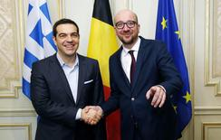 Belgian Prime Minister Charles Michel poses with his Greek counterpart Alexis Tsipras (L) ahead of a meeting in Brussels February 12, 2015. REUTERS/Francois Lenoir
