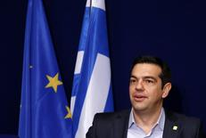 Greek Prime Minister Alexis Tsipras addresses a news conference after a European Union leaders summit in Brussels February 12, 2015. REUTERS/Francois Lenoir