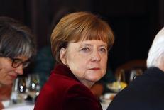 Канцлер Германии Ангела Меркель на встрече с вице-президентом США Ддо Байденом и президентом Украины Петром Порошенко в Мюнхене. 7 февраля 2015 года. Киев, Москва, Мюнхен, Вашингтон, Оттава, Минск, Брюссель - и всё за одну рабочую неделю. Неутомимые усилия Ангелы Меркель в посредничестве в мирном урегулировании на Украине и сохранении Греции в зоне евро удостоились похвал из уст даже самых яростных критиков канцлера Германии. REUTERS/Michaela Rehle