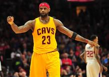 January 16, 2015; Los Angeles, CA, USA; Cleveland Cavaliers forward LeBron James (23) reacts during the 126-121 victory against the Los Angeles Clippers in the second half at Staples Center. Mandatory Credit: Gary A. Vasquez-USA TODAY Sports